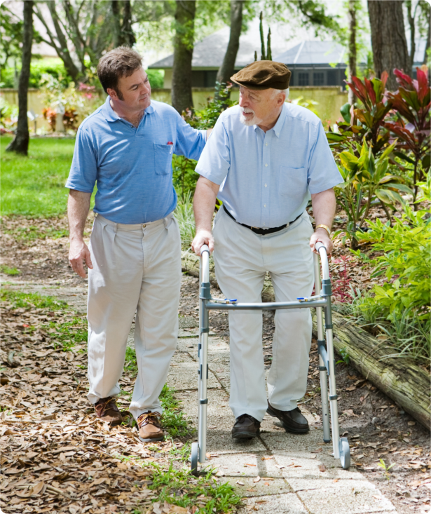 senior man with his son walking in the garden